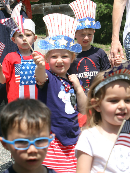 Annual Memorial Day parade at Building Blocks Preschool & Kindergarten. Quinn McCabe, 3, of Lowell, center waving flag, Matthew Chace, 4, of Lowell, right rear, Tori Arvilla, 4, of Tewksbury, right front, and Mikey Martinez, 4, of Lowell, front left. [NOTE: boy in red ok to use in photo, but not ID] (SUN/Julia Malakie)