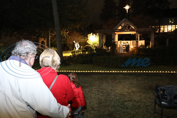 Visitors come to see a live Nativity at the Pyron's residence at 212 W. Dobbs Ave.