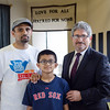 Furqan Mehmud, his son Rayyan, 11, and Mayor Stephen DiNatale discuss Friday's Ramadhan dinner sponsored by the Ahmadiyya Muslim Community of Fitchburg. SENTINEL & ENTERPRISE / Ashley Green
