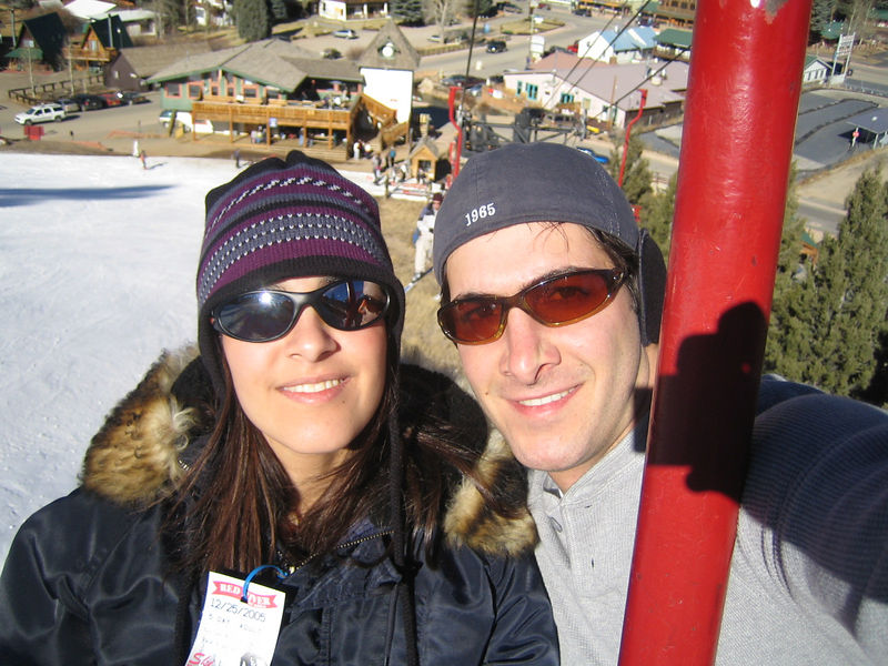 Aaron and his sister Shirene riding the Red Lift up the mountain. The trail in the background is called the Face.