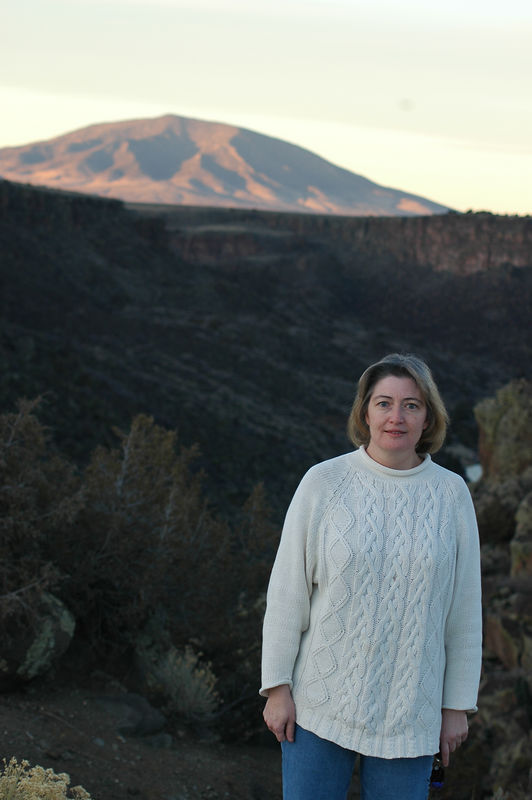Susan Sandoval posing in front of Rio Grande Gorge near Questa NM