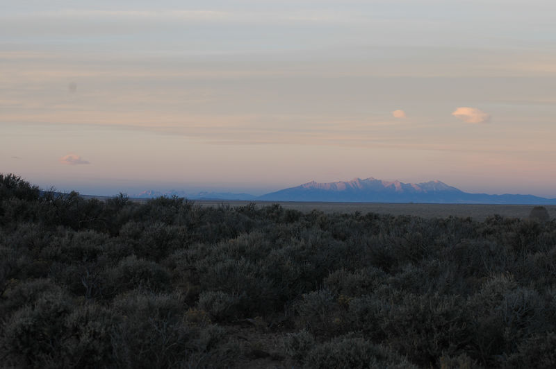 The high sierra terrain of Wild Rivers Nat'l Rec Area, NM. The first set of mountains with Culebra Peak (14,069') is about 40 miles north while the second with Blanca Peak (14345') is 70-80 miles away.