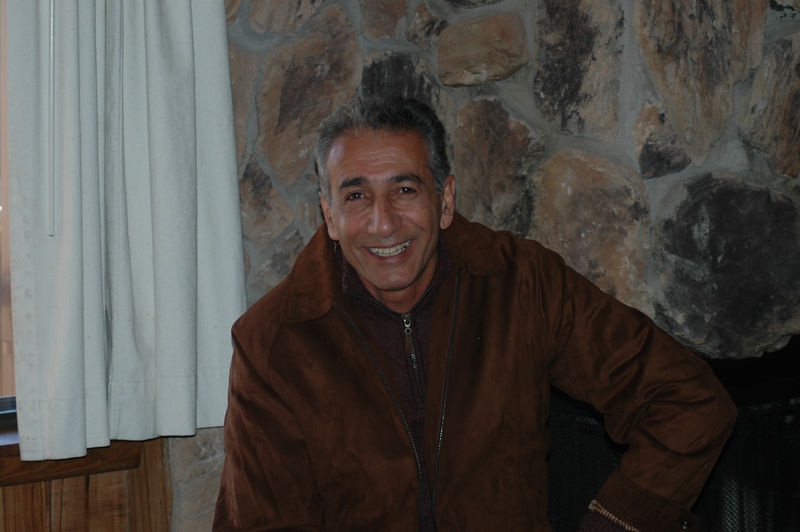 Asghar Kadkhodai relaxing near the fireplace.