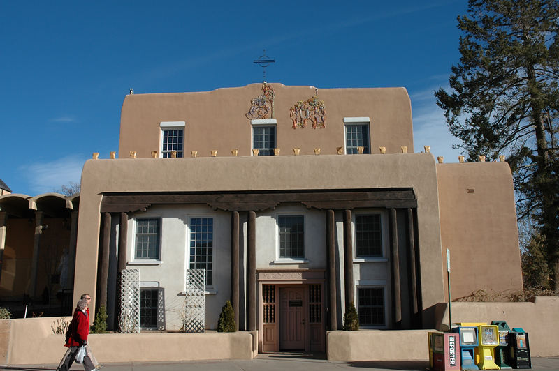 Santa Fe architecture is almost exclusively of this adobe style. No joke, you won't find a mirrored window anywhere. No Xmas lights either, except for luminaries which can be seen on this structure.