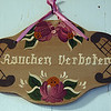 "A decorative sign in the kitchen. I think the word ""verboten"" means forbidden. Not sure about the word ""rauchen."" My guess is that it is the German word for ""rowdiness"" or perhaps ""noisy behavior."""