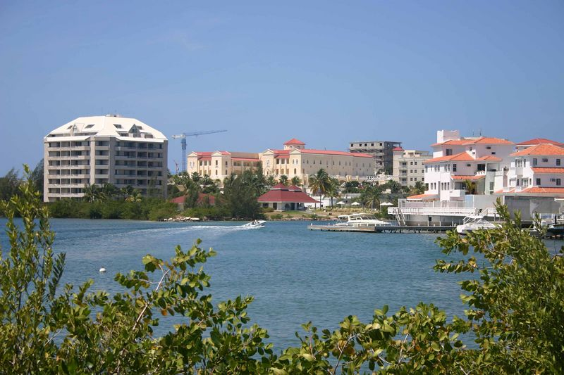 There are many condominiums built beside the water and overlooking the golf course.   In Saint Martin, private condominiums and time share apartments far outnumber hotel rooms.  The economy is totally dependent on tourism - there is no agriculture or manufacturing of any kind.  About 60,000 people live on the island full-time, many of whom are recent migrants from Haiti.   The Haitians are welcome because they are willing to work in the menial jobs in hotels and on construction.