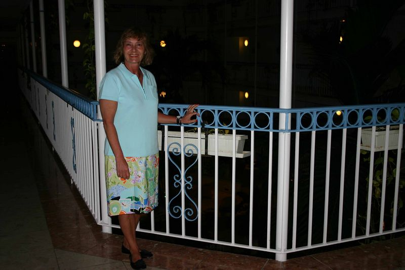 Here, Francine is standing by the railing beside the inside courtyard.