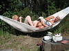 Sanna and her brother Lauri squeezing into the hammock at their summer place in Finland.