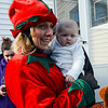 Mary Jane Diconza greets Madison Johnson as the Santa Express rides through Leominster delivering gifts to families in need on Sunday morning. Two-year-old Madison is battling brain cancer. SENTINEL & ENTERPRISE / Ashley Green