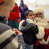 Santa, a good friend of Mark Clark's, rides into Crossroads Church in Fitchburg to surprise the congregation on Sunday morning. Spencer Whitley, 4, greets Santa. SENTINEL & ENTERPRISE / Ashley Green