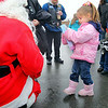 "Haley Fairbanks looks over her toy she just got from Santa when she meet him in the parking lot of the Dippin' Donutsin Fitchburg were he and other gathered to get ready for this years ""Santa Express"" ride. SENTINEL & ENTERPRISE/JOHN LOVE"