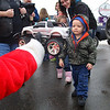 "Santa gives a toy to Jacob Fairbanks, 3, in the parking lot of Dippin' Donuts as he and others got ready for the ""Santa Express"" ride in the City of Fitchburg on Saturday morning. SENTINEL & ENTERPRISE/JOHN LOVE"