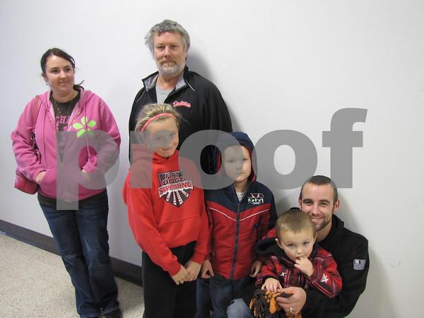 Sara Sankey, Greg Lombard, Tori Bennett, Owen and Mason Lombard with dad Matt Lombard, await Santa's arrival.