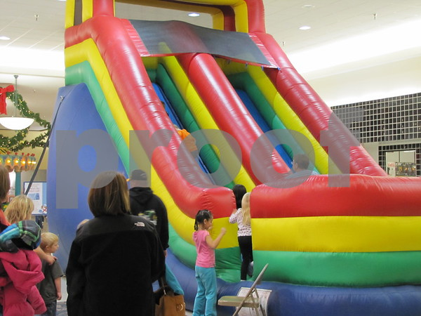 An inflatable slide was a big hit with the kids who came out to welcome Santa to the Crossroads Mall Saturday.