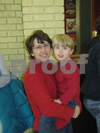Rae Lynn Larson and son, Erik, wait in line for a hotdog while the line to Santa shortens.