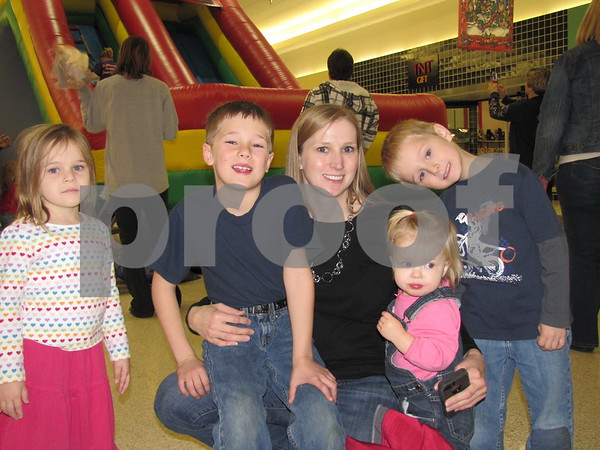 Kaela, Andrew, Melissa, Ethan, and Josephine Webster had a great time on the inflatable slide.