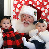 Last visit of Santa Claus to the Lowell Doctors Park building at 75 Arcand Drive, which will demolished to make room for an expanded Lowell High School. Santa Claus with Aubriella Rodriguez, 4 months, of Lowell, left, and Zoey Doyle, 8 months, of Groton. (SUN/Julia Malakie)