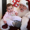 Last visit of Santa Claus to the Lowell Doctors Park building at 75 Arcand Drive, which will demolished to make room for an expanded Lowell High School. Maggie Pattison, 9 months old, of Candia, N.H., with Santa. (SUN/Julia Malakie)