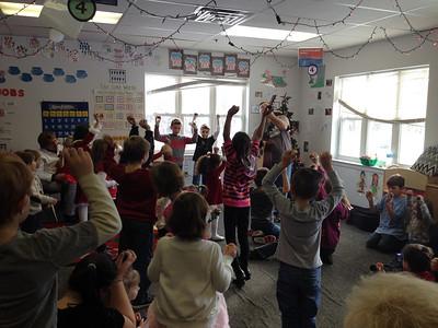 Santa visits children at The Goddard School of Gilbertsville; Musician Mike Kropp performs.