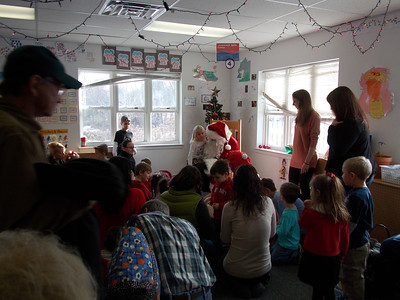 Santa visits children at The Goddard School of Gilbertsville; Musician Mike Kropp performs.