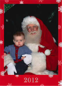 A very stoic Edmund with Santa Claus 2012