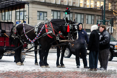 Holiday carriage rides in Monument Square.