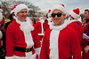 Santarchy DC 2011 : Dec 17, 2011 National Mall, Washington DC Santarchy takes place in major cities all over the world involving tens of thousands of Santas. It is a non-profit, non-political, non-religious & non-sensical celebration of holiday cheer, goodwill, and fun. There is no good reason to dress up in cheap Santa suits, run around town, give gifts, sing songs, have strangers sit on our laps, and decide who is naughty or nice -- but it's a lot of fun -- so Santa does it anyway. Everyone loves Santa and Santa loves everyone! Santarchy is your chance to be Santa, so step up and be jolly. [ Click on the SLIDESHOW bar for a full screen presentation ]