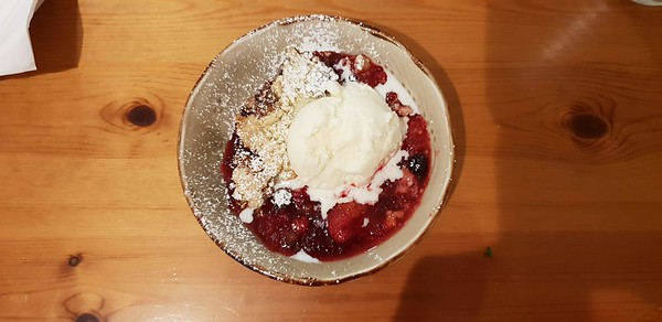 Fruit Coulis, with some crumble mix scattered over, put under the grill and served with ice cream
