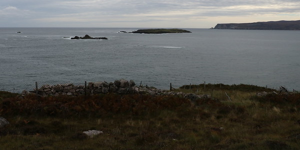 Whiten Head in the distance with A' Ghoil-sgeir and Eilean Hoan in the middle distance, from the A837 near Sangobeg.