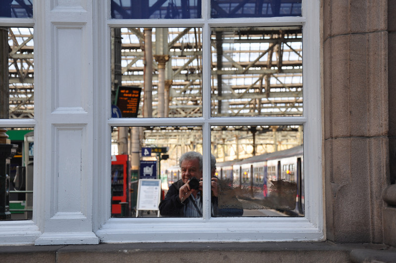 Ian reflected in a window at Edinburgh Waverley Station before catching the train to London King's Cross