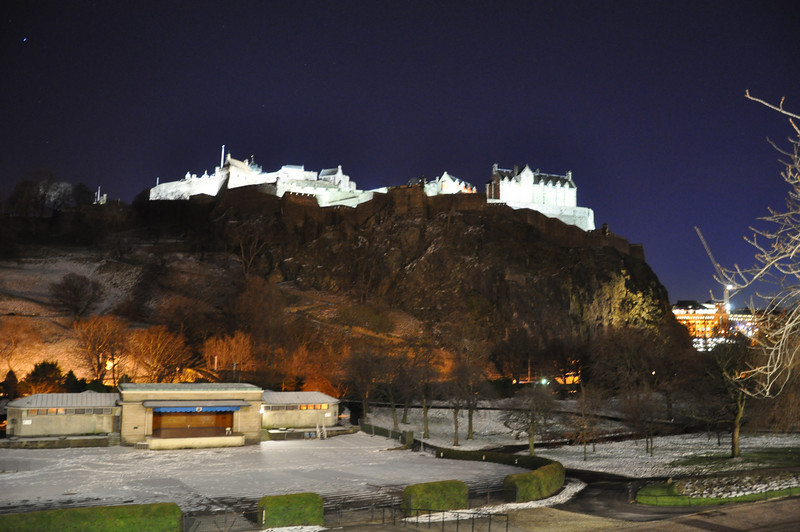 Floodlit Edinburgh Castle dominates the skyline