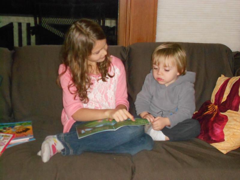 Beija reading to Mason