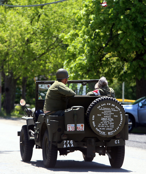 Memorial Day observance at Village Cemetery in Shirley. Vehicle in procession moving on to next stop. (SUN/Julia Malakie)