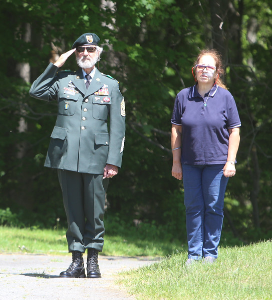Memorial Day observance at Village Cemetery in Shirley. US Army special forces veteran Lou Criess, and his wife Leslie Seidel, of Shirley. (SUN/Julia Malakie)