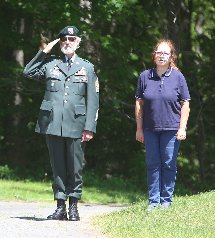 . Memorial Day observance at Village Cemetery in Shirley. US Army special forces veteran Lou Criess, and his wife Leslie Seidel, of Shirley. (SUN/Julia Malakie)