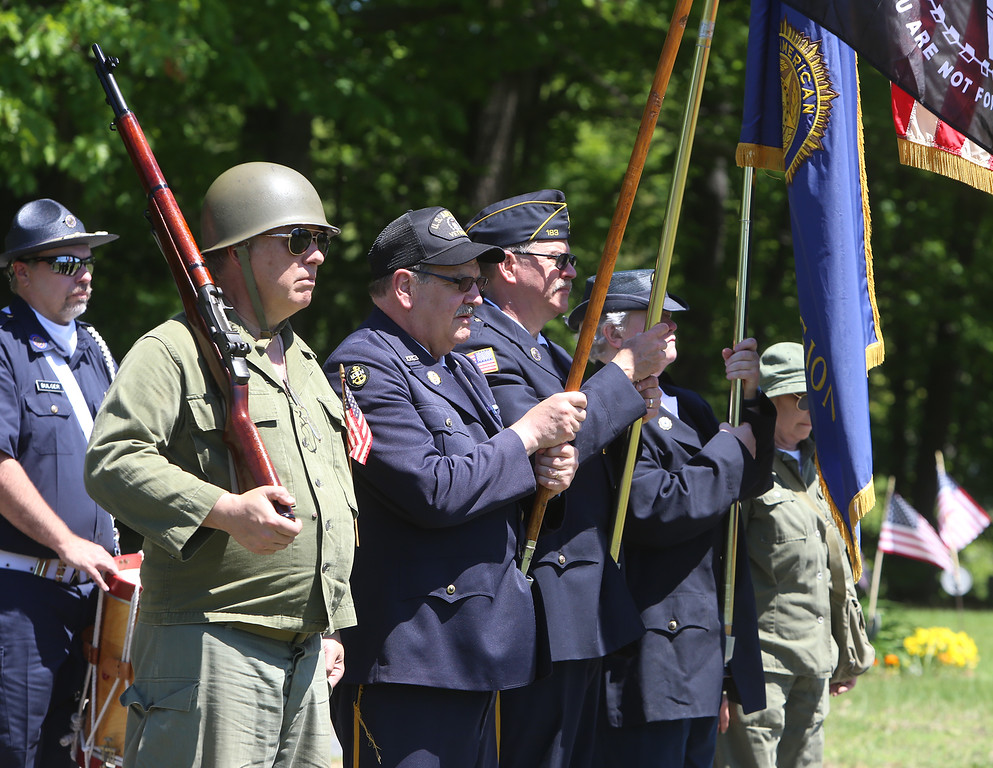 . Memorial Day observance at Village Cemetery in Shirley. Front, from left, Tom Sommer of West Groton, Dana Abbott of Ayer, Michael Flood of Shirley and Karen Blood of Shirley. (SUN/Julia Malakie)