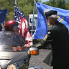Memorial Day observance at Village Cemetery in Shirley. Gerry Wheeler of Shirley, on his Honda Goldwing, and Lou Criess of Shirley, right, talk before moving on to the next stop at St. Anthony's. (SUN/Julia Malakie)