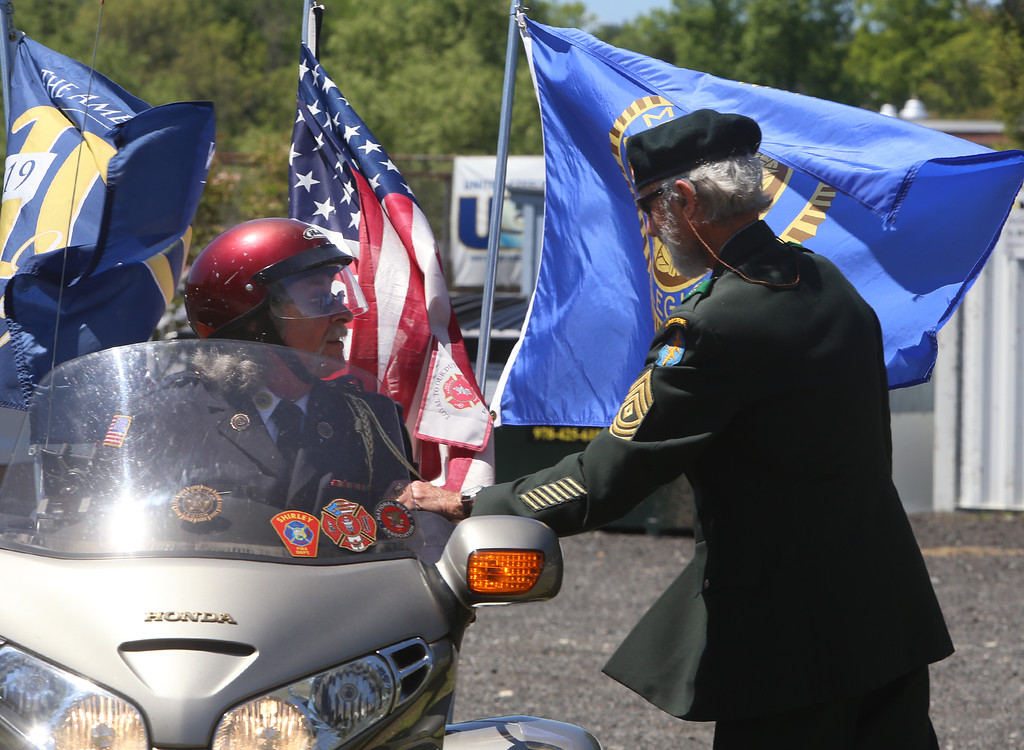 . Memorial Day observance at Village Cemetery in Shirley. Gerry Wheeler of Shirley, on his Honda Goldwing, and Lou Criess of Shirley, right, talk before moving on to the next stop at St. Anthony\'s. (SUN/Julia Malakie)