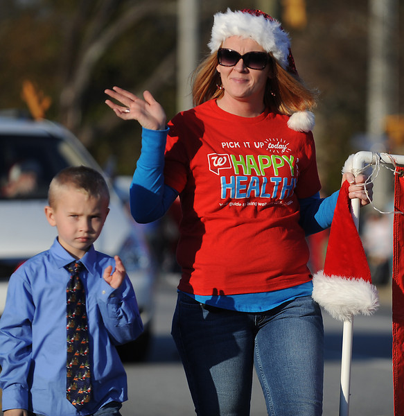 The Simpsonville Christmas Parade excites the crowd that lined Main Street in Simpsonville.<br /> GWINN DAVIS PHOTOS<br /> gwinndavisphotos.com (website)<br /> (864) 915-0411 (cell)<br /> gwinndavis@gmail.com  (e-mail) <br /> Gwinn Davis (FaceBook)