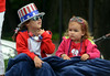 Abby, left, and Cate McDonald wait for start of Fourth of July Parade in Skippack.   Friday, July 4, 2014.   Photo by Geoff Patton