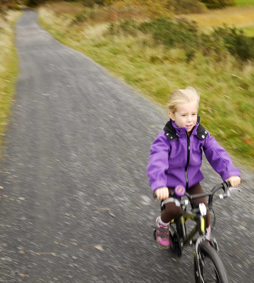 Zoë heading towards Barmouth bridge, three-quarters through the 6 mile ride