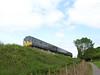 Class 115 DMU leaves Washford working the 1315 Minehead-Bishops Lydeard