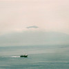Hydrofoil crossing the bay of Naples with Vesuvius peeping through the early morning clouds
