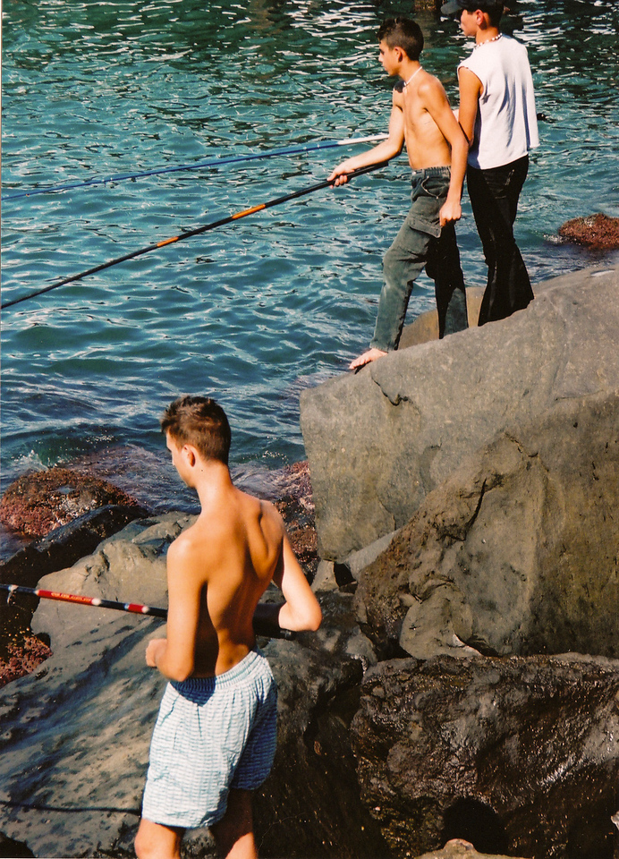 Local boys fishing near the harbour in Sorrento