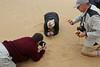 Swakopmund - Living Desert Tour - Brian, Brenda and Neil Photographng the Spider