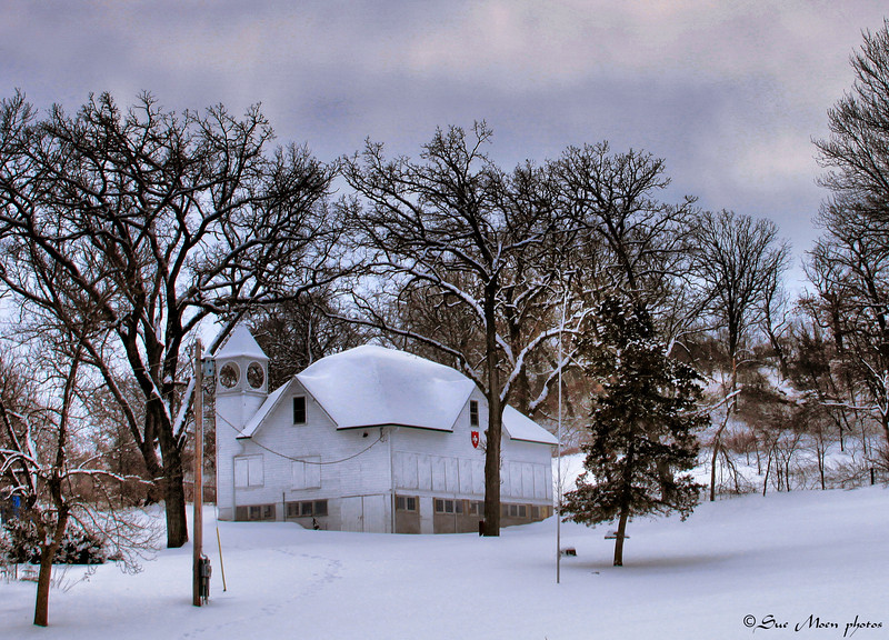 The historic Schutzen Barn in New Glarus WI after a morning snowfall.