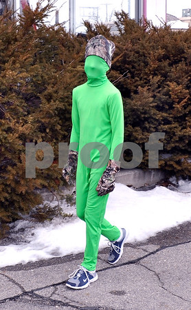 -Messenger photo by Joe Sutter<br /> <br /> Little green men? Sam Bohan, 8, of Humboldt, got to walk in the parade for the first time this year, wearing his green Halloween costume.