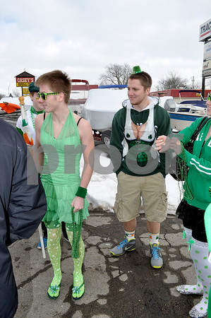 -Messenger photo by Joe Sutter<br /> <br /> Steven McCall, left in the dress and tights, and Brandon Aument, right, in the women's torso apron and tiny hat, show off some alternative Irish apparel for the Algona St. Pat's parade. Aument said he dressed like this for his girlfriend Jeannie McCall, right. A McCall was one of the founders of the parade.