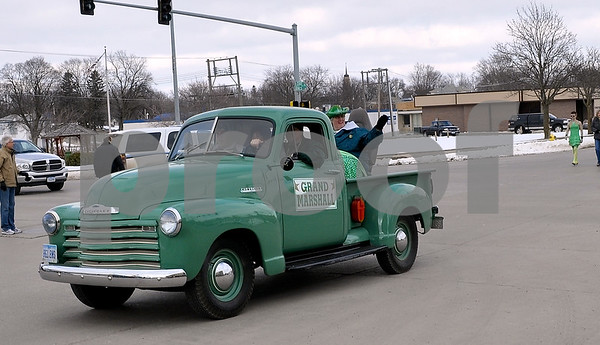 -Messenger photo by Joe Sutter<br /> <br /> Grand Marshall Colleen Hegarty waves to the crowd in the Algona St. Patrick's Day parade. Hegarty was chosen for her Irish heritage, past involvement with the parade, and general kindness to others, said parade organizers.