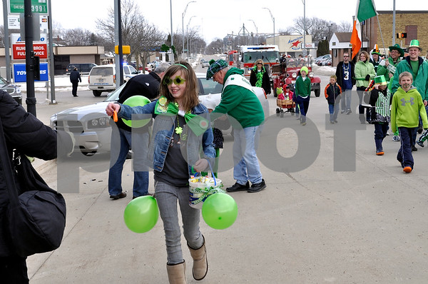 -Messenger photo by Joe Sutter<br /> <br /> Cars aren't allowed in the parade, so Mary Beth Armstrong hung the balloons from herself to compliment her other St. Pat's stuff.